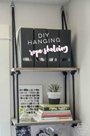 diy hanging shelves and farewell office lemon thistle diy hanging rope shelving such a fun alternative to a bookshelf