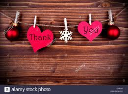 the words thank you on two heart with christmas or winter