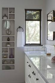 before after a brooklyn inspired bath in los angeles remodelista above the cabinet hardware is restoration hardware s aubrey pull and aubrey knob in an oil rubbed bronze finish the mirrors are stealth cabinets they re