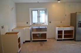 Hang Kitchen Cabinets Diwyatt Installing The Base Cabinets Loving Here