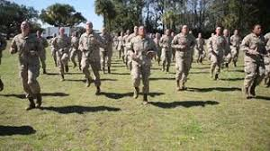 soldiers in basic do exercises on an outdoor field