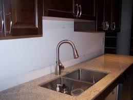 need help with backsplash have kashmir white countertop and java