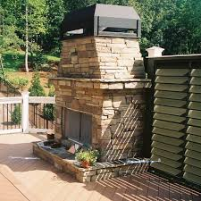 outdoor fireplaces that are designed properly like the one pictured here instantly become focal