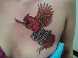 flying cardinal tattoo on front shoulder