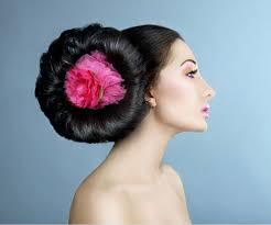 pics of black pretty big hair buns with added hair colossal the enormous shiny bun secured on side with a pink red
