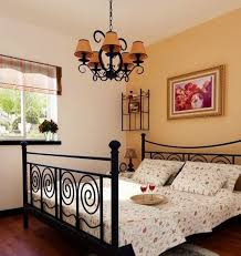 nice sheets bedroom yellow chandeliers and walls of bedroom with country bed