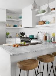 sleek and clean scandinavian kitchen with white ceramic backsplash