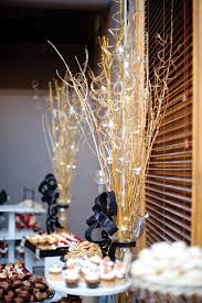 black and gold centerpieces for tables tall gold centerpieces perfectly complemented the city feel