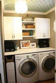 home laundry room cabinets storage organization white laundry room cabinet and shelves ideas