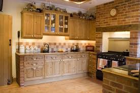 cottage style kitchen ideas brick wall decor and maple wooden cabinet for cottage style kitchen