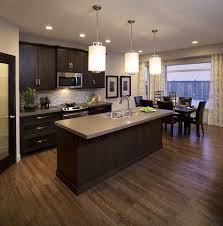 what color floor goes with brown cabinets brown cabinet brown kitchen cabinets wood floor kitchen
