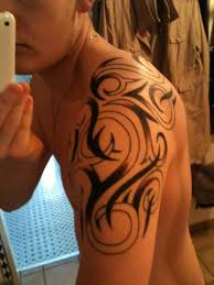 tribal aries tattoo on shoulder back photos pictures and