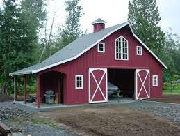 garage maroon and white themed metal barns with living quarters