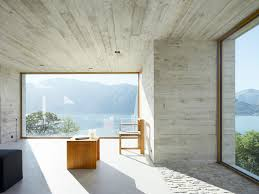 ceramic floor tiles and exposed concrete wall modern house design