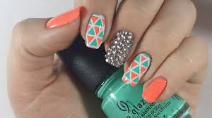 geometric rhinestone nails gel polish with reverse stamping and