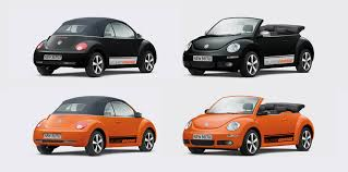 volkswagen orange vw beetle blackorange breaks the grey world to pieces