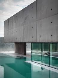 glass walls exposed concrete concrete and glass home in urgnano