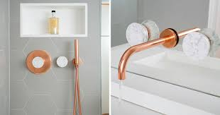 This Bathroom Features Copper And Marble Fixtures Next To Light Gray Copper Bathroom Fixtures
