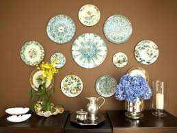 15 ways to dress up your dining room walls hgtv s decorating 13 plate collection eclectic dining room with wall art plates