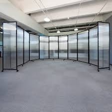 let in the light with a clear room divider office space
