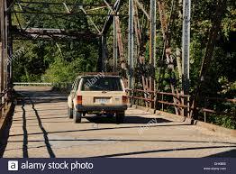 old jeep cherokee old jeep cherokee suv drives over an truss girder box bridge