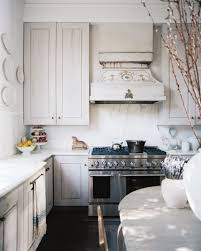 white shabby chic kitchen featuring stainless steel appliances and