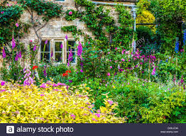 English Cottage Gardens Photos - a pretty english cottage garden in the cotswold village of bibury