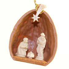 center nutshell with nativity ornament