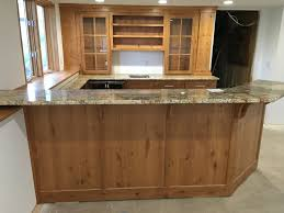 furniture wet bar cabinets with granite countertop and floating