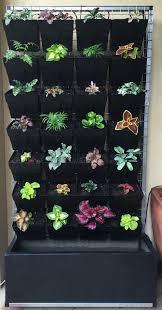 complete indoor unit self watering with plants vertical