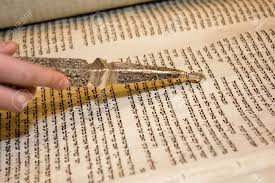 torah yad an torah scroll being read at a bar mitzvah with a
