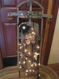 primitive christmas wreaths sled with grapevine wreath snowman