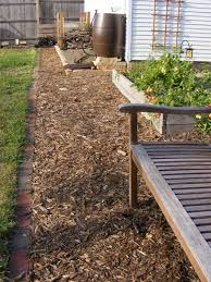 Landscaping Wood Chips by How To Build A Wood Chip Path In Your Garden This Spring Diys