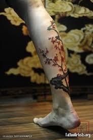 cherry blossom tattoo design on leg cherry blossoms lower leg