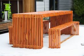 cedar outdoor table and benches darren scott design
