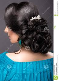 hairstyles back view only beautiful girl in a blue dress with evening make up and hairstyle