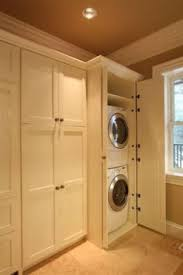 bathroom cabinet with built in laundry her built in washer dryer hide away your laundry machine where no one