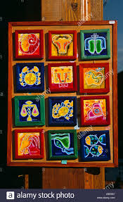 brightly coloured framed ceramic tile display outside gift and