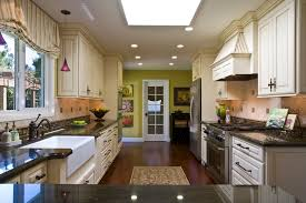 verde peacock granite kitchen eclectic with apron sink cream