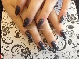 almond shaped nails with gun metal grey gel polish nails