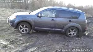 off road subaru forester mitsubishi outlander and subaru forester on gravel and mud off