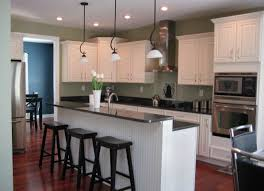 decorating white wooden kraftmaid cabinets with black countertop