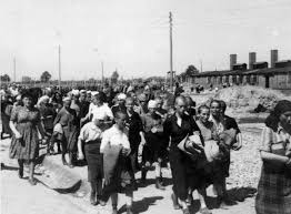 female prisoners are escorted to the barracks by the blockälteste