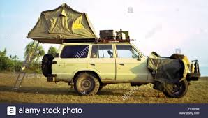 african safari car african safari vehicle tanzania tanzanian toyota land cruiser roof