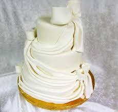 white draped wedding cake kosher cakery