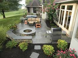 Backyard Brick Patio Design With 12 X 12 Pergola Grill Station by Work With Professionals To Create A Landscaping Layout That Works