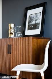 design trend dark interiors designs by human bar area feng apartment by designs by human the dark grey walls actually helped