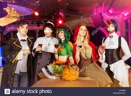 group of friends in halloween costumes stock photo royalty free