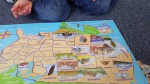 wooden usa map puzzle with states and capitals let s play usa map puzzle and learn the 50 states and each capital