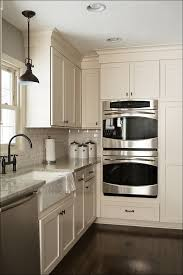 kitchen gray cabinets with white countertops black kitchen
